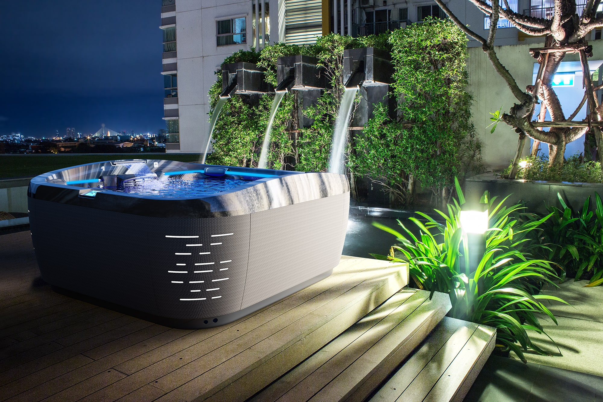 J-575 Jacuzzi Hot Tub installation at night in Sarasota